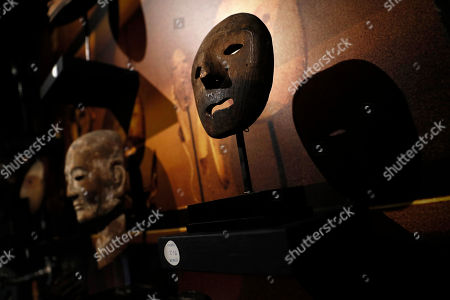 Masks of different origins which belonged to late French industrialist and patron Pierre Berge on display during the presentation of the 'Pierre Berge: From One Home to Another' auction at Sotheby's auction house in Paris, France, 26 October 2018. The auction runs from 29 October to 31 October.