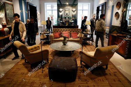 Bidders look at pieces of furniture and works of art which belonged to late French industrialist and patron Pierre Berge during the presentation of the 'Pierre Berge: From One Home to Another' auction at Sotheby's auction house in Paris, France, 26 October 2018. The auction runs from 29 October to 31 October.