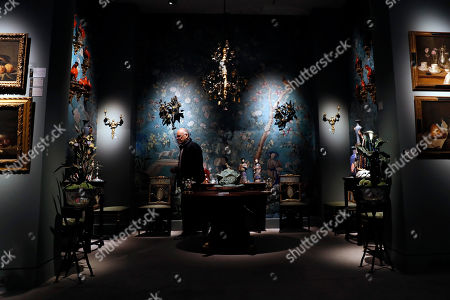 A bidder looks at pieces of furniture and works of art which belonged to late French industrialist and patron Pierre Berge during the presentation of the 'Pierre Berge: From One Home to Another' auction at Sotheby's auction house in Paris, France, 26 October 2018. The auction runs from 29 October to 31 October.