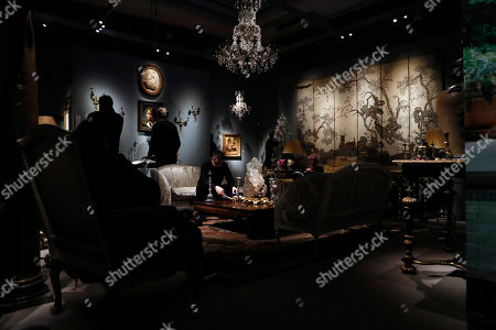Stock Picture of Bidders look at pieces of furniture and works of art which belonged to late French industrialist and patron Pierre Berge during the presentation of the 'Pierre Berge: From One Home to Another' auction at Sotheby's auction house in Paris, France, 26 October 2018. The auction runs from 29 October to 31 October.