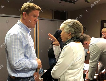 Brendan Kelly, Democratic candidate for Illinois' 12th congressional district, speaks with a voter at a town hall at Southern Illinois University in Carbondale, Ill. Kelly is trying to retake a Southern Illinois House seat that Democrats held for more than 30 years before Republican Mike Bost won it in 2014