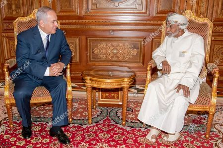 Stock Image of Sultan of Oman Qaboos bin Said Al Said (R) meets with Israeli Prime Minister Benjamin Netanyahu (L), Muscat, Oman, 26 October 2018. Reports state Netanyahu made an unannounced visit to Oman, an Arab country that has no diplomatic ties with Israel, where he had talks with Sultan Qaboos on the peace process in the Middle East as well as several matters of joint interest.
