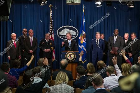 """Jeff Sessions, Christopher A. Wray, James P. O'Neill, Geoffrey Berman, Thomas E. Brandon, William F. Sweeney, Jr., Gary Barksdale, Randolph """"Tex"""" Alles, Matthew Verderosa, John Demers. FBI Director Christopher Wray points to a question during a news conference about the arrest of Cesar Sayoc, 56, of Aventura, Fla., in the package bomb case, during a news conference at the Department of Justice, in Washington. Wray is accompanied by Attorney General Jeff Sessions, left, FBI New York Field Office Assistant Director in Charge William Sweeney, Jr., New York Police Department Commissioner James O'Neill, Chief of U.S. Capitol Police Matthew Verderosa, U.S. Attorney Geoffrey Berman for the Southern District of New York, John Demers Assistant Attorney General for the National Security Division, U.S. Postal Inspection Service Deputy Chief Gary Barksdale, ATF Deputy Director Thomas Brandon, and U.S Secret Service Director Randolph """"Tex"""" Alles"""