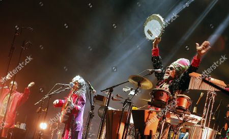 Brazilian band Tribalistas members Arnaldo Antunes, Marisa Monte and Carlinhos Brown perform on stage during their concert at the Multiusos Fontes do Sar in Santiago de Compostela, northern Spain, 26 October 2018.