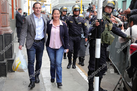 Peruvian opposition leader Keiko Fujimori (C) and husband Marik Vito de Villanella (L) leave the National Criminal Court of Lima after a judicial hearing was canceled, in Lima, Peru, 26 October 2018. Keiko attended court for a hearing over 36-month preventive detention requested, by Anti-corruption prosecutor Jose Domingo Perez, against her and another 10 people over money laundering allegations.