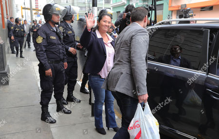 Peruvian opposition leader Keiko Fujimori (C) and husband Marik Vito de Villanella (R) leave the National Criminal Court of Lima after a judicial hearing was canceled, in Lima, Peru, 26 October 2018. Keiko attended court for a hearing over 36-month preventive detention requested, by Anti-corruption prosecutor Jose Domingo Perez, against her and another 10 people over money laundering allegations.