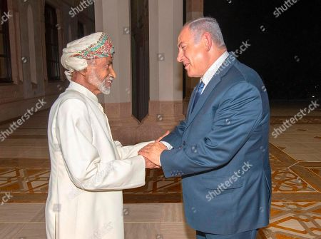 In this photo was released by Oman News Agency, Oman's Sultan Qaboos, left, receives Israeli Prime Minister Benjamin Netanyahu in Muscat, Oman, . Israel and Oman do not have diplomatic relations. The meeting was the first between leaders of the two countries since 1996 and former Israeli premier Yitzhak Rabin made a similar surprise visit to Oman two years earlier