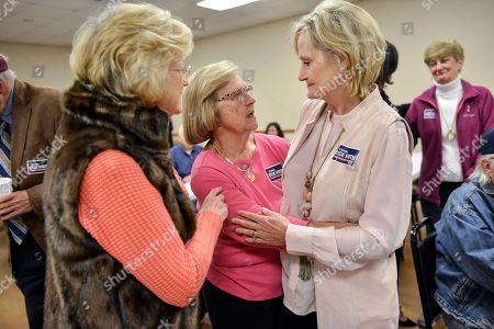 US Senator Cindy Hyde-Smith, right, speaks with Ann Todd, left, and Joyce Haslip during a campaign stop at the Northwest Mississippi Association of Realtors office in Nesbit, Mississippi, USA, 26 October 2018. Hyde-Smith was appointed to the US Senate by Mississippi Governor Phil Bryant after Senator Thad Cochran resigned. A special election to fill the seat will be held on 7 November 2018, the same day as the regularly scheduled Senate election for the seat currently held by Roger Wicker.