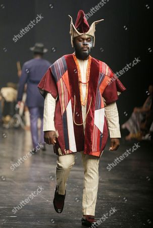A model displays a creation by Ugo Monye during the Fashion and Design Week in Lagos, Nigeria