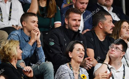 Romeo Beckham and David Beckham attend the Wheelchair Basketball Final at the Invictus Games