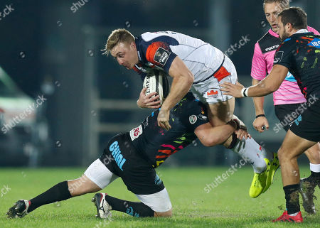 Dougie Fife - Edinburgh Rugby full back is tackled by Oliviero Fabiani of Zebre Rugby Club