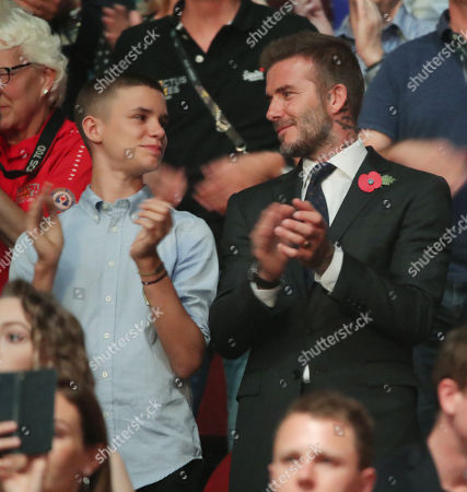 Stock Image of Romeo Beckham and David Beckham attend the Closing Ceremony at the Invictus Games at the Qudos Bank Arena