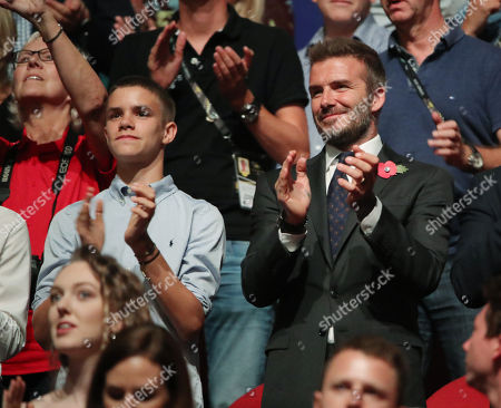 Romeo Beckham and David Beckham attend the Closing Ceremony at the Invictus Games at the Qudos Bank Arena