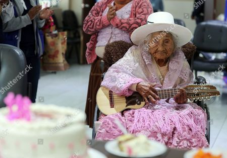 Julia Flores Qolque, better known as 'Mama Julia', considered the oldest woman in Bolivia and probably in the world, celebrates in a typical costume her 118 years, in Sacaba, Bolivia, 26 October 2018. Sacaba's City Hall wants to present 'Mama Julia' to the Guiness World Record to be recognized as the eldest person in Bolivia and in the world as she will be 118 years-old on 26 October 2018.