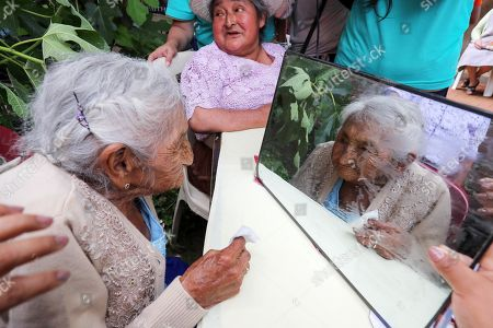 Stock Photo of Julia Flores Qolque, better known as 'Mama Julia', considered the oldest woman in Bolivia and probably in the world, celebrates in a typical costume her 118 years, in Sacaba, Bolivia, 26 October 2018. Sacaba's City Hall wants to present 'Mama Julia' to the Guiness World Record to be recognized as the eldest person in Bolivia and in the world as she will be 118 years-old on 26 October 2018.