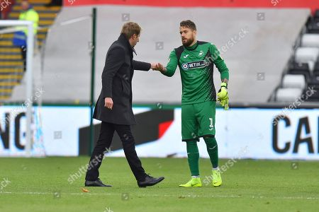 Swansea City manager Graham Potter congratulates goalkeeper Kristoffer Nordfeldt (1) of Swansea City at full time after his team won 2-0 during the EFL Sky Bet Championship match between Swansea City and Reading at the Liberty Stadium, Swansea