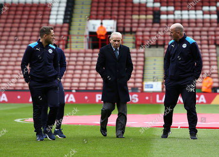 Wigan Athletic manager Paul Cook alongside Peter Reid ahead of the game