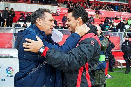 Girona's head coach Eusebio Sacristan (L) greets Rayo Vallecano's head coach Miguel Angel Sanchez (R) prior to the Spanish La Liga soccer match between Girona FC and Rayo Vallecano in Girona, northeastern Spain, 27 October 2018.