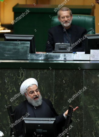 Iranian President Hassan Rouhani (below) speaks to the parliament to defend his nominations for four ministries as Iranian parliament speaker Ali Larijani (top) listens, during a parliament session in Tehran, Iran, 27 October 2018. Iranian parliament will review four nominees for ministries of Economic, Labour, roads and urban, and industry and mine. Media reported that Rouhani said in his speech that US is isolated against Iran, with EU supports Iran against the US is a rare victory for Iran.