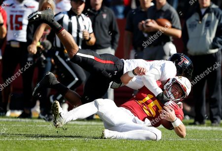 Stock Photo of Iowa State quarterback Brock Purdy (15) is tackled by Texas Tech defensive back John Bonney during the first half of an NCAA college football game, in Ames, Iowa