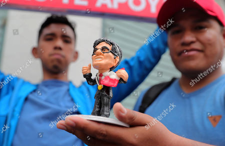 A man holds a figurine of Peruvian Attorney General Jose Domingo Perez, who is investigating Peruvian opposition leader Keiko Fujimori, in Lima, Peru, 27 October 2018. Dolls, drawings, t-shirts and event a march to demand the building of a monument in his honor has turned young Attorney General Jose Domingo Perez into a popular icon of the anti-corruption fight for many Peruvians.