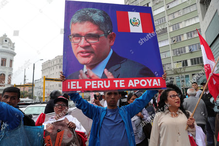 A man holds a sign depicting Peruvian Attorney General Jose Domingo Perez, who is investigating Peruvian opposition leader Keiko Fujimori, in Lima, Peru, 27 October 2018. Dolls, drawings, t-shirts and event a march to demand the building of a monument in his honor has turned young Attorney General Jose Domingo Perez into a popular icon of the anti-corruption fight for many Peruvians.
