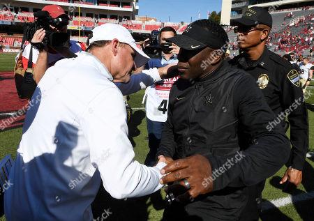 Stock Image of Arkansas coach Chad Morris, left, and Vanderbilt coach Derek Mason shake hands after Vanderbilt's win in an NCAA college football game, in Fayetteville, Ark