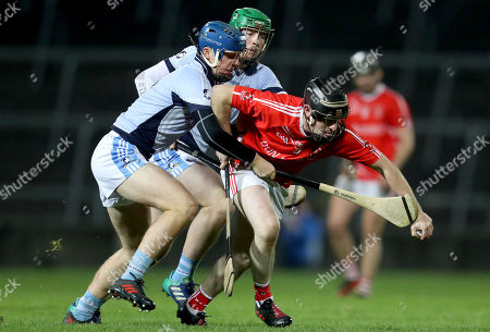 Stock Image of Doon vs Na Piarsaigh. Na Piarsaigh's Jerome Boylan and Shane Dowling with John Hayes of Doon