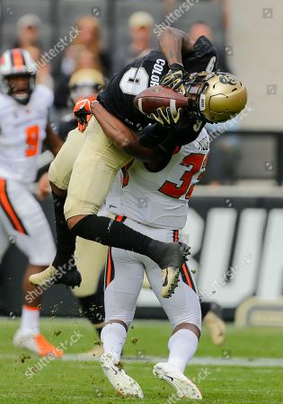 Colorado Buffaloes wide receiver Juwann Winfree (9) catches a pass over Oregon State Beavers safety Jalen Moore (33) during the first half of an NCAA football game, in Boulder, Colo