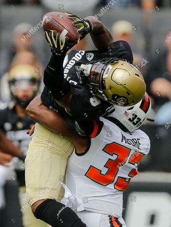 Juwann Winfree, Jalen Moore. Colorado Buffaloes wide receiver Juwann Winfree (9) catches a pass over Oregon State Beavers safety Jalen Moore (33) during the first half of an NCAA football game, in Boulder, Colo