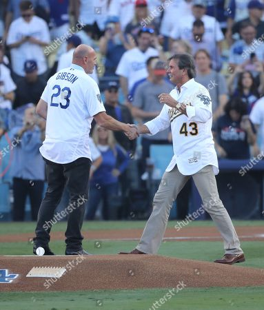 Former Los Angeles Dodgers player Kirk Gibson (L) and former Oakland As pitcher Dennis Eckersley (R) embrace after the ceremonial first pitch before the start of game four of the World Series between the Boston Red Sox and the Los Angeles Dodgers at Dodger Stadium in Los Angeles, California, USA, 27 October 2018. The Red Sox lead the best-of-seven series 2-1 to determine the champion of Major League Baseball.