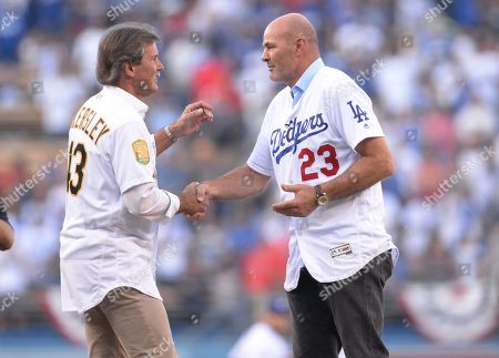 Former Los Angeles Dodgers player Kirk Gibson (R) and former Oakland As pitcher Dennis Eckersley (L) embrace after the ceremonial first pitch before the start of game four of the World Series between the Boston Red Sox and the Los Angeles Dodgers at Dodger Stadium in Los Angeles, California, USA, 27 October 2018. The Red Sox lead the best-of-seven series 2-1 to determine the champion of Major League Baseball.