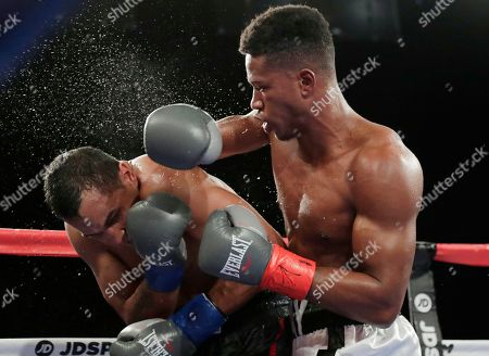 Stock Photo of Patrick Day, Elvin Ayala. Patrick Day, right, punches Elvin Ayala during the eighth round of a WBC Continental Americas super welterweight championship boxing match, in New York. Day won the fight
