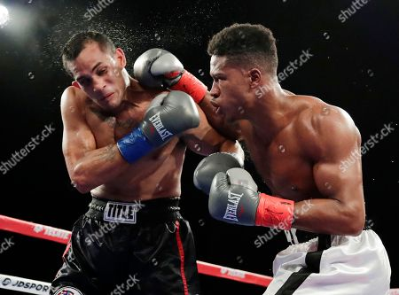 Stock Image of Patrick Day, Elvin Ayala. Patrick Day, right, punches Elvin Ayala during the fifth round of a WBC Continental Americas super welterweight championship boxing match, in New York. Day won the fight