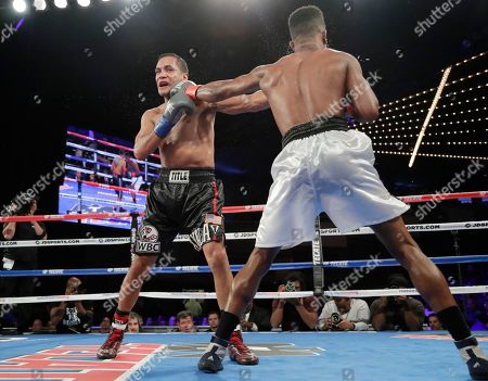 Stock Picture of Patrick Day, Elvin Ayala. Patrick Day, right, punches Elvin Ayala during the 10th round of a WBC Continental Americas super welterweight championship boxing match, in New York. Day won the fight