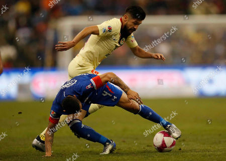 Stock Picture of America's Oribe Peralta, top, and Cruz Azul's Julio Dominguez, fight for the ball during a Mexican soccer league match at Azteca stadium in Mexico City