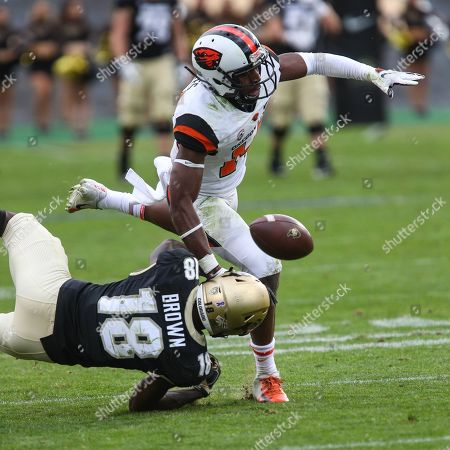 2bbb9453c46 Colorado s Tony Brown can t come up with the catch as Oregon State s Kaleb  Hayes