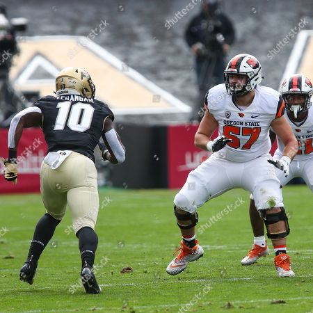 170c93d90d6 Oregon State lineman Trent Moore gets set to block Colorado s Alex Tchangam  at Folsom Field in