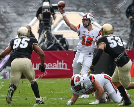 9c394f82568 Oregon State QB Jack Colletto floats a pass against Colorado at Folsom  Field in the first