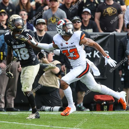 82cdaccfeed Colorado s Tony Brown and Oregon State s Isaiah Dunn look for the ball at  Folsom Field in