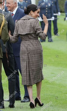 Meghan Duchess of Sussex attends a traditional welcome ceremony on the lawns of Government House in Wellington.