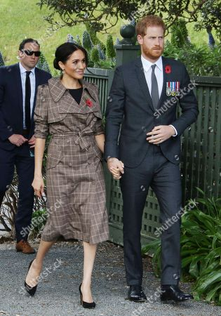 Prince Harry and Meghan Duchess of Sussex attend a traditional welcome ceremony on the lawns of Government House in Wellington.