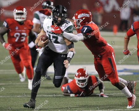 Hawaii quarterback Cole McDonald is tackled by Fresno State linebacker James Bailey during the second half of an NCAA college football game in Fresno, Calif., . Fresno State won 50-20