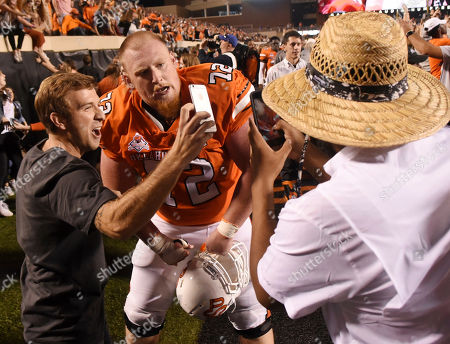 Stock Photo of Oklahoma State offensive lineman Johnny Wilson takes a photo with fans following an NCAA college football game in Stillwater, Okla., . Wallace had 2 touchdowns in the Oklahoma State 38-35 win over Texas