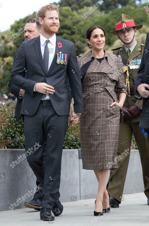 Prince Harry and Meghan Duchess of Sussex, at the Pukeahu National War Memorial Park in Wellington, New Zealand, on day thirteen of their Royal Tour.