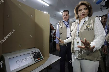 Head of the OAS Electoral Observation Mission and Former President of Costa Rica, Laura Chinchilla, accompanied by a observer, visit a polling station in Brasilia, Brazil, . Jair Bolsonaro, presidential candidate with the Social Liberal Party, is running against leftist candidate Fernando Haddad of the Workers' Party