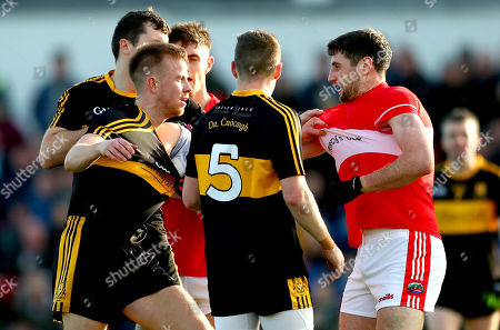 Stock Photo of Dr. Crokes vs Dingle. Dr. Crokes' Michael Moloney and Fionn Fitzgerald clash with Paul Geaney of Dingle