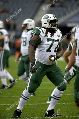 New York Jets offensive guard James Carpenter (77) warms up before an NFL football game against the Chicago Bears, in Chicago