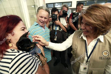 Costa Rican former president Laura Chinchilla (R), chief of the OAS observers' mission, visits a polling station during the second round of the presidential election, in Brasilia, Brazil, 28 October 2018. Around 147 millions Brazilians are called to vote in the second round of the country's presidential elections, where far-right candidate Jair Bolsonaro is favorite to win in all surveys. Fernando Haddad of the Workers Party will face Jair Bolsonaro, of the Social Liberal Party (PSL) in the second round of voting.