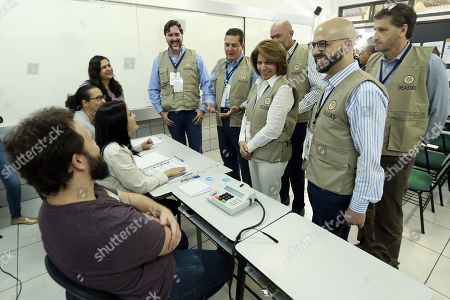 Costa Rican former president Laura Chinchilla (c), chief of the OAS observers' mission, visits a polling station during the second round of the presidential election, in Brasilia, Brazil, 28 October 2018. Around 147 millions Brazilians are called to vote in the second round of the country's presidential elections, where far-right candidate Jair Bolsonaro is favorite to win in all surveys. Fernando Haddad of the Workers Party will face Jair Bolsonaro, of the Social Liberal Party (PSL) in the second round of voting.